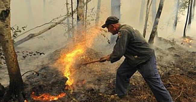 Siberian field fires sweep through 21 villages, injure 70