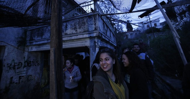 AP PHOTOS: On Greek island, rockets mark Orthodox Easter