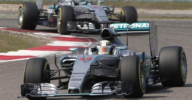 Hamilton wins Chinese Grand Prix; Rosberg unhappy