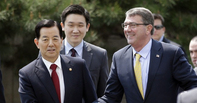 On Carter's first Asia trip as Pentagon chief, calm prevails