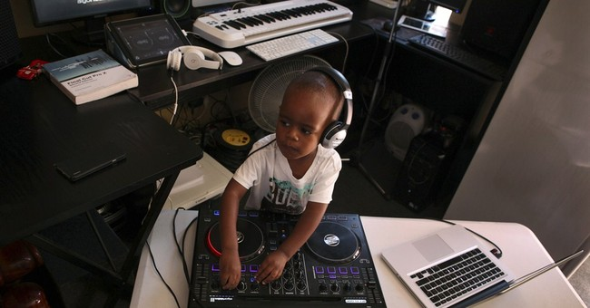 A toddler disc jockey fascinates South African fans