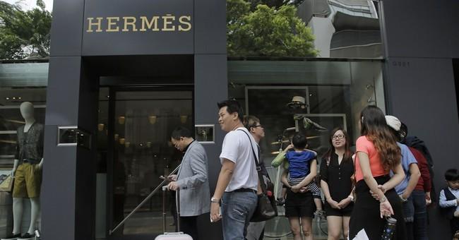 China curbs some travel to Hong Kong to cool tensions