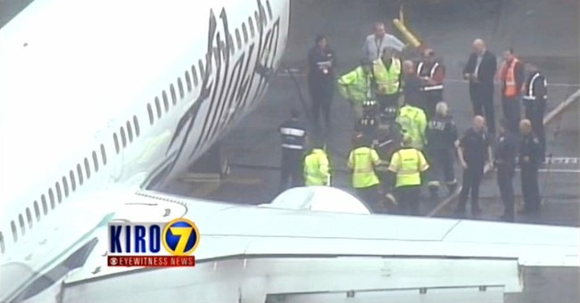 Flight returns to Seattle after worker trapped in cargo hold