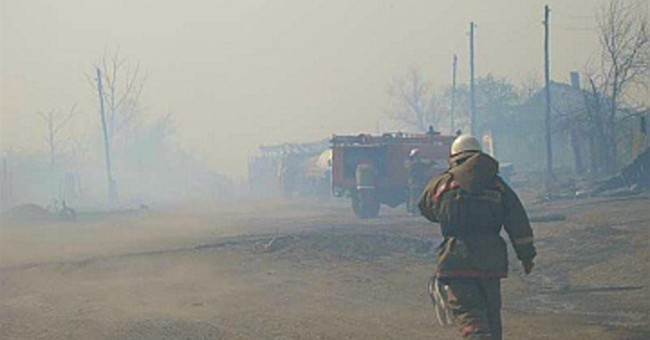 Siberian fires sweep through villages, kill 15