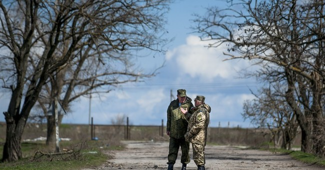 Fighting in eastern Ukraine rages on overnight despite talks
