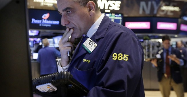 Stocks waver in midday trade after mixed earnings reports