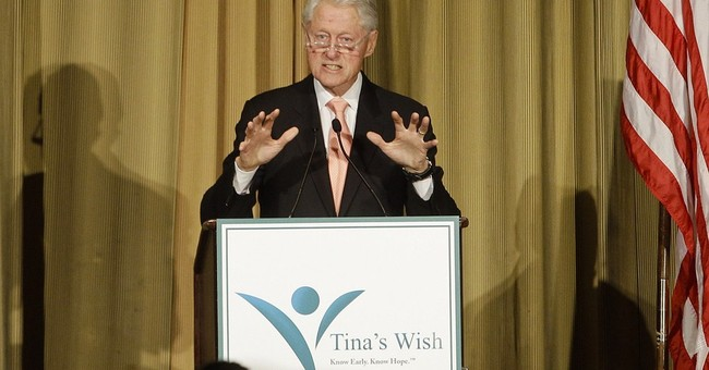 In speech, Bill Clinton makes no mention of wife's campaign