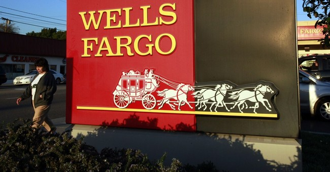 Wells Fargo net income falls slightly from a year earlier