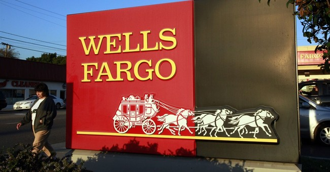 Wells Fargo net income falls slightly from a year earlier