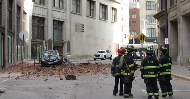 Bricks fall 9 stories onto Cleveland street, crush minivan