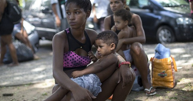 Brazil police oust squatters from would-be Olympic hotel