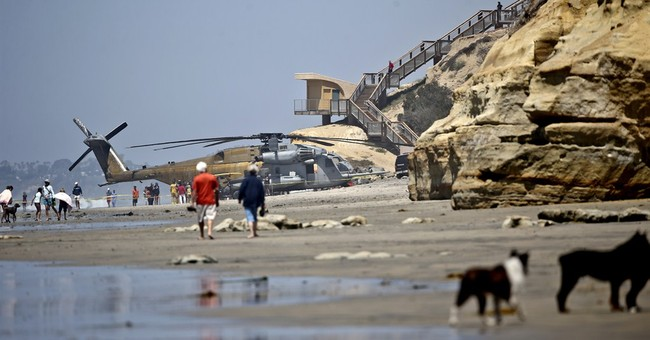 Marine helicopter is forced to land on California beach