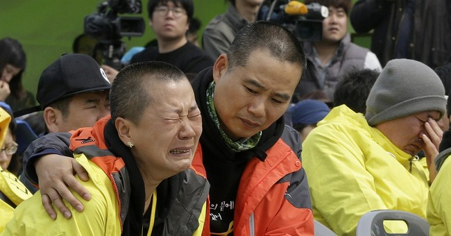 Tears, anger mark 1st anniversary of SKorean ferry disaster