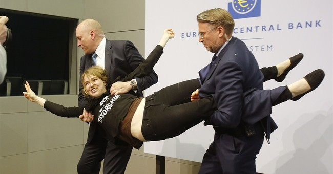 Protester rushes ECB chief Draghi at press conference