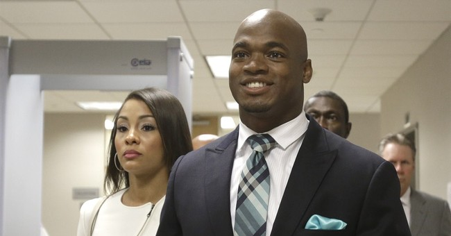 NFL reinstates Adrian Peterson from suspension