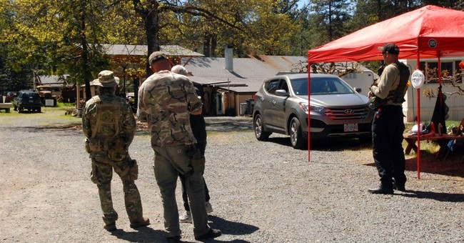 Owner of mining claim urges armed supporters to stand down