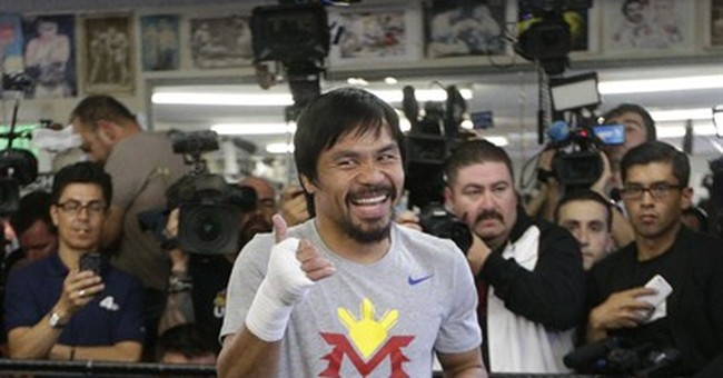 """Manny Pacquiao fights back at Mayweather's """"reckless"""" jabs"""