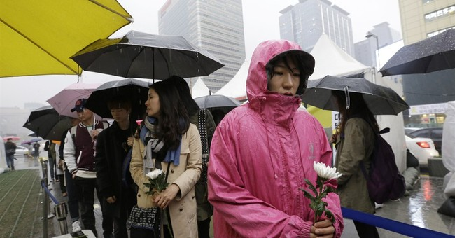 Angry kin unmoved by S. Korean leader's vow to salvage ferry