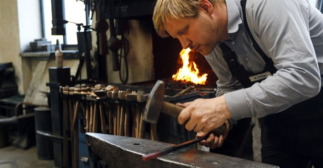 Blacksmith creates replica of stolen Dachau camp gate