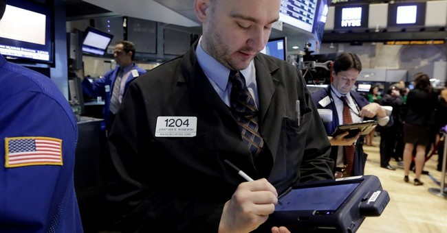 Giving up an afternoon gain, US stocks close slightly lower