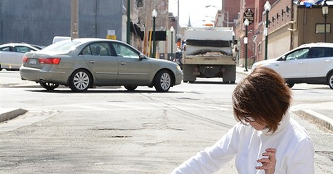 NY woman tackles pothole problem by planting pansies there