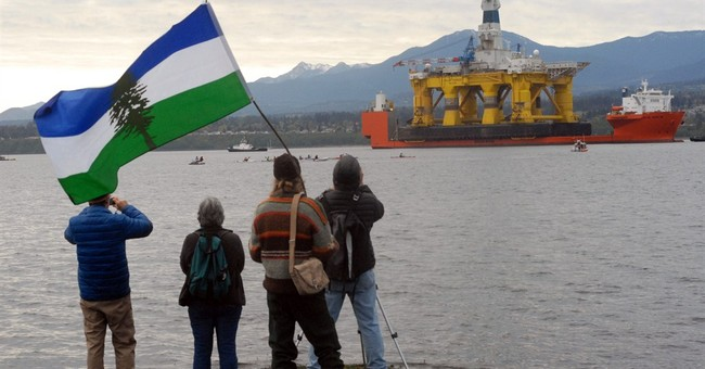 Protesters meet Arctic drill rig in Washington harbor