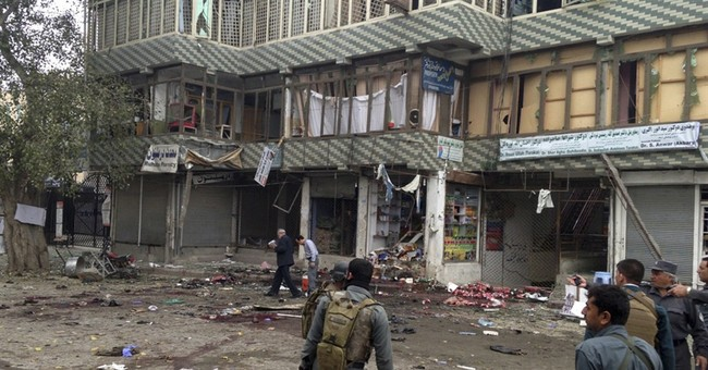 Islamic State blamed for Afghan suicide bombing killing 35