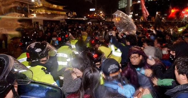 S. Korean police question dozens after violent ferry protest