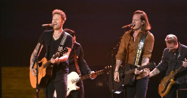 Lambert wins 4, but Luke Bryan takes top prize at ACM Awards