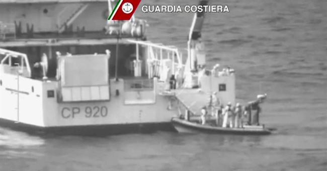 The Latest: Migrant survivor says 950 aboard capsized boat