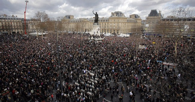 Quarrelsome French bond at rally to protect nation's values