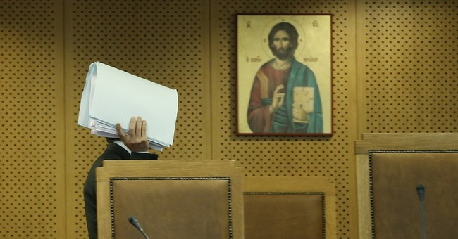 Greece's far-right leader, lawmakers go on trial