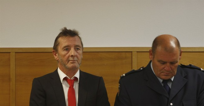 AC/DC drummer Phil Rudd pleads guilty to threatening to kill