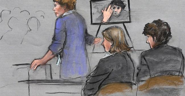 Photo, video of Tsarnaev making obscene gesture released