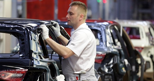Low wages, trade deals luring auto plants and jobs to Mexico