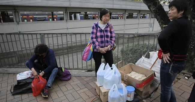Defiant Hong Kongers resist embrace of mainland China