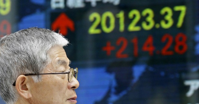 Japan's Nikkei closes at 15-year high, Europe stocks down