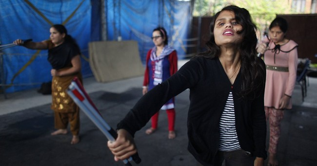 AP PHOTOS: Nepal blind women find courage in defense classes