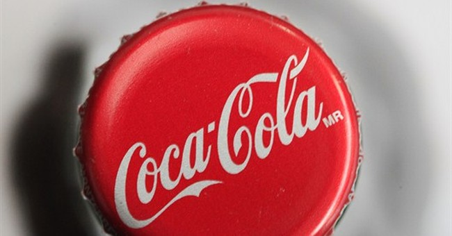 Coke profit tops expectations, helped by price hikes