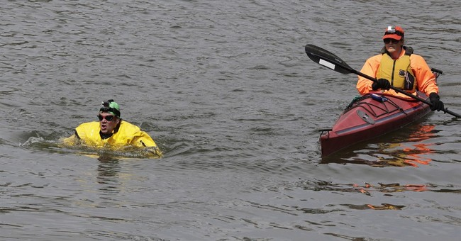 Clean-water advocate takes Earth Day swim at Superfund site
