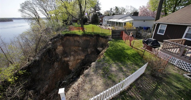Owners of homes at risk of sliding into river told to leave