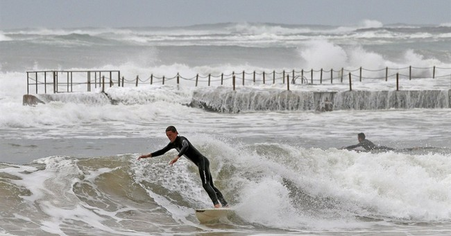 Image of Asia: Riding the waves as Australia hit by storms