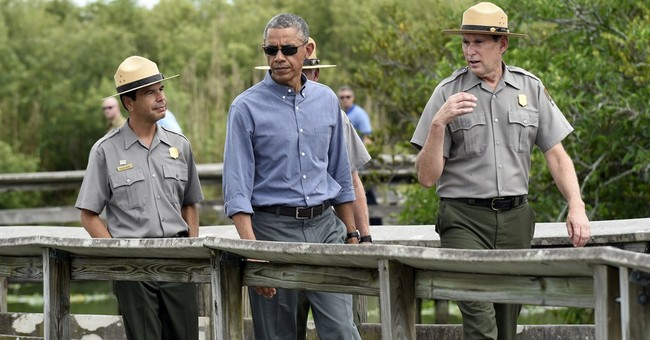 Obama sounds alarm on climate damage in visit to Everglades