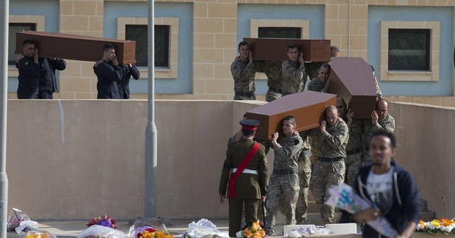 Europe buries migrants as lawyer defends suspected captain