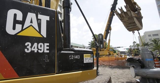 Caterpillar trumps Street 1Q expectations, raises forecast