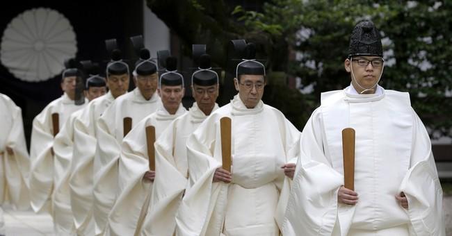 Japan ministers' war shrine visit irks China after Abe talks