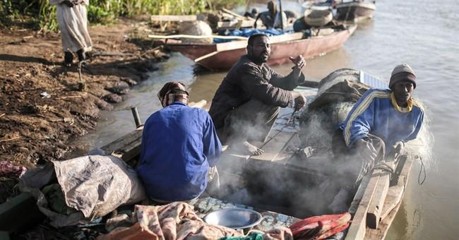 AP PHOTOS: Afloat on 2 Niles with the fishermen of Khartoum