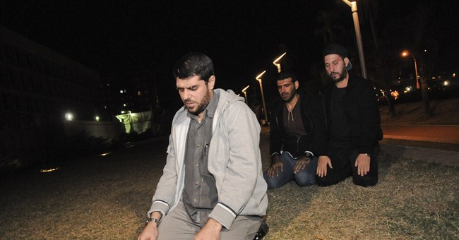 Former Guantanamo detainees keep up protest in Uruguay