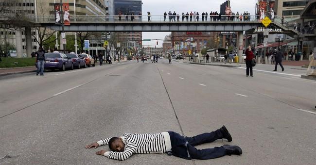 Latest on police-custody death: Officer injured near station