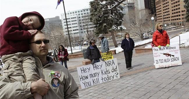 As theater shooting trial opens, gun debate dwindles